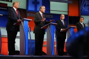 Republican presidential candidates from left, Donald Trump, Jeb Bush, Mike Huckabee and Ted Cruz take the stage for the first Republican presidential debate at the Quicken Loans Arena Thursday, Aug. 6, 2015, in Cleveland. (AP Photo/Andrew Harnik)