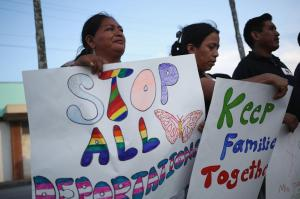 HOMESTEAD, FL - JULY 09: Donatila Diego, originally from Guatemala, (L) and Juana de Leon, originally from Guatemala, stand with others as they show their support for the Obama administration's immigration reform plan on July 9, 2015 in Homestead, Florida. The organizers held the protest the night before the 5th Circuit Court of Appeals in New Orleans is expected to consider lifting the injunction on the Obama administrations executive action to allow parents of U.S. citizens and legal permanent residents to gain temporary status in the U.S., as well as to expand the deferred action program for undocumented youth. (Photo by Joe Raedle/Getty Images)